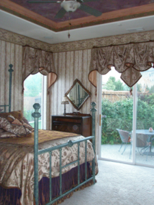 Custom-designed bedroom: faux painted ceiling, window treatments, wall paper, bed & bedding.