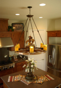 SW Dining Room: Custom designed wagon wheel chandelier with downlights over center island.