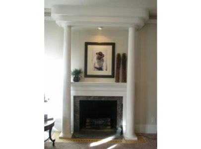 Art Deco Style: Fireplace with granite slab and inlaid wood border.