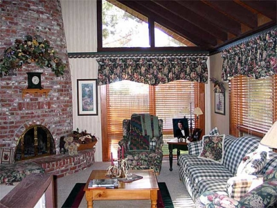Window Treatments & Coordinating Furniture; Floral Swag over Fireplace & Custom Area Rug.