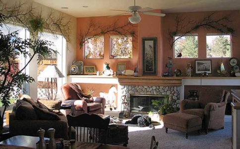 Iron Sculptured Branches over windows; Persimmon Wall, Faux Painted Mantel with added colors to Hearth & Stone.