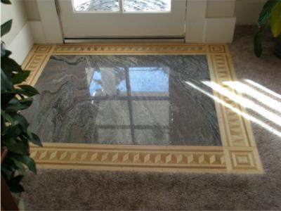 Entry Floor: Granite Slab with Inlaid Wood.