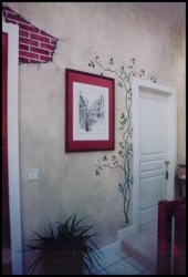 An Artist's Touch can add interest even to the smallest areas! Small area of Hand-painted Faux Brick Work w/ Ivy Vines surrounding Door and Artwork.
