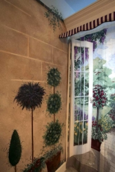 Painted Stone Wall & Topiaries.