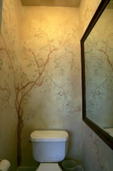 Tree Mural reflected in a large Mirror makes this small bathroom appear larger.