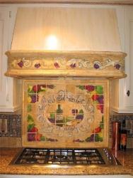 Custom, Hand-Painted Tile on backsplash behind stove
