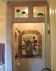 Custom shower with a hand-painted tile mural.