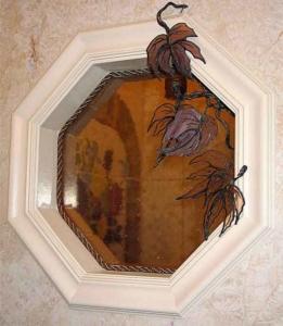 Octagonal window built into shower; custom vine accessory.