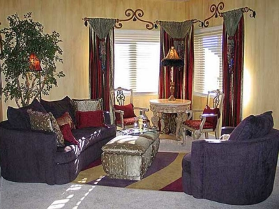 Silk Drapes with Beads with Coordinating Lamp; Custom Made Area Rug; Hand-fauxed Watermarked Walls, Hand-Painted and Beaded Scroll Designs between Drapes.